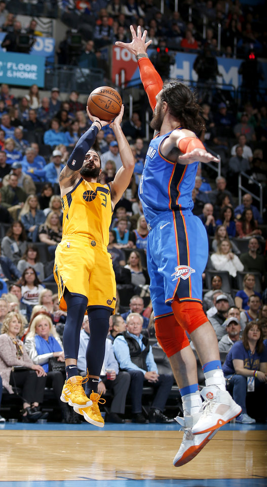 Photo - Oklahoma City's Steven Adams (12) defends against Utah's Ricky Rubio (3) during the NBA game between the Oklahoma City Thunder and the Utah Jazz at the Chesapeake Energy Arena, Friday, Feb. 22, 2019. Photo by Sarah Phipps, The Oklahoman