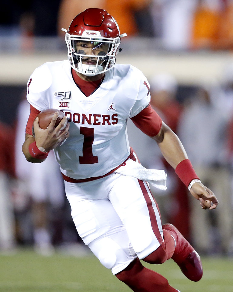 Photo - Oklahoma's Jalen Hurts (1) rushes in the second quarter during the Bedlam college football game between the Oklahoma State Cowboys (OSU) and Oklahoma Sooners (OU) at Boone Pickens Stadium in Stillwater, Okla., Saturday, Nov. 30, 2019. OU won  34-16. [Sarah Phipps/The Oklahoman]