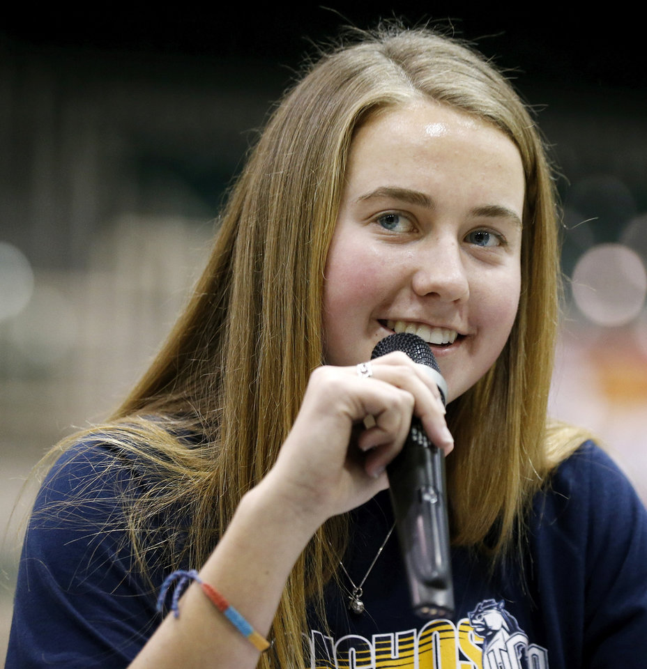 Photo - Soccer player Ashley Snider speaks to those gathered for a national signing day ceremony at Edmond Santa Fe High School in Edmond, Okla., Wednesday, Feb. 4, 2015. Snider signed to play soccer at the University of Central Oklahoma. Photo by Nate Billings, The Oklahoman