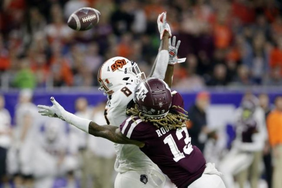 Photo -  Oklahoma State cornerback Rodarius Williams (8) interferes in the attempted reception by Texas A&M receiver Kendrick Rogers (13) during the first half Friday of the Texas Bowl in Houston. [AP Photo/Michael Wyke]