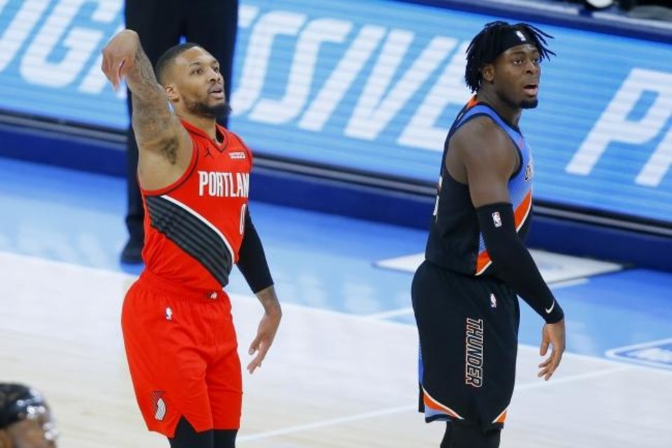 Photo -  Portland's Damian Lillard (0) watches as he makes a 3-pointer beside Oklahoma City's Luguentz Dort (5) during the Trail Blazers' 115-104 win Tuesday night at Chesapeake Energy Arena. [Bryan Terry/The Oklahoman]