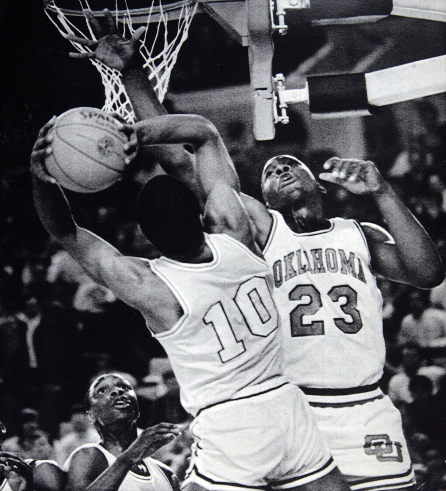 Photo - Former OU basketball player Wayman Tisdale. TULSA, Okla. March 14 - GOING FOR THE BLOCK -- Oklahoma center Wayman Tisdale, 23, goes for the block against North Carolina A&T guard Jimmy Brown during first half action Thursday night at the NCAA Midwest Regional Basketball Tournament in Tulsa, Okla. The fourth-ranked Sooners led the Aggies 49-35 at the half. (AP LaserPhoto) Photo by David Longstreath. Photo taken 3/14/1985, photo published 3/15/1985 in The Daily Oklahoman. ORG XMIT: KOD