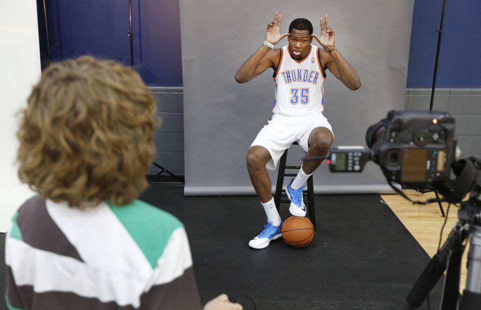 Photo - Tabius Landsberger, 11, takes a photo of Kevin Durant during media day with the Oklahoma City Thunder in Oklahoma City, Thursday September  27, 2013. Photo By Steve Gooch, The Oklahoman