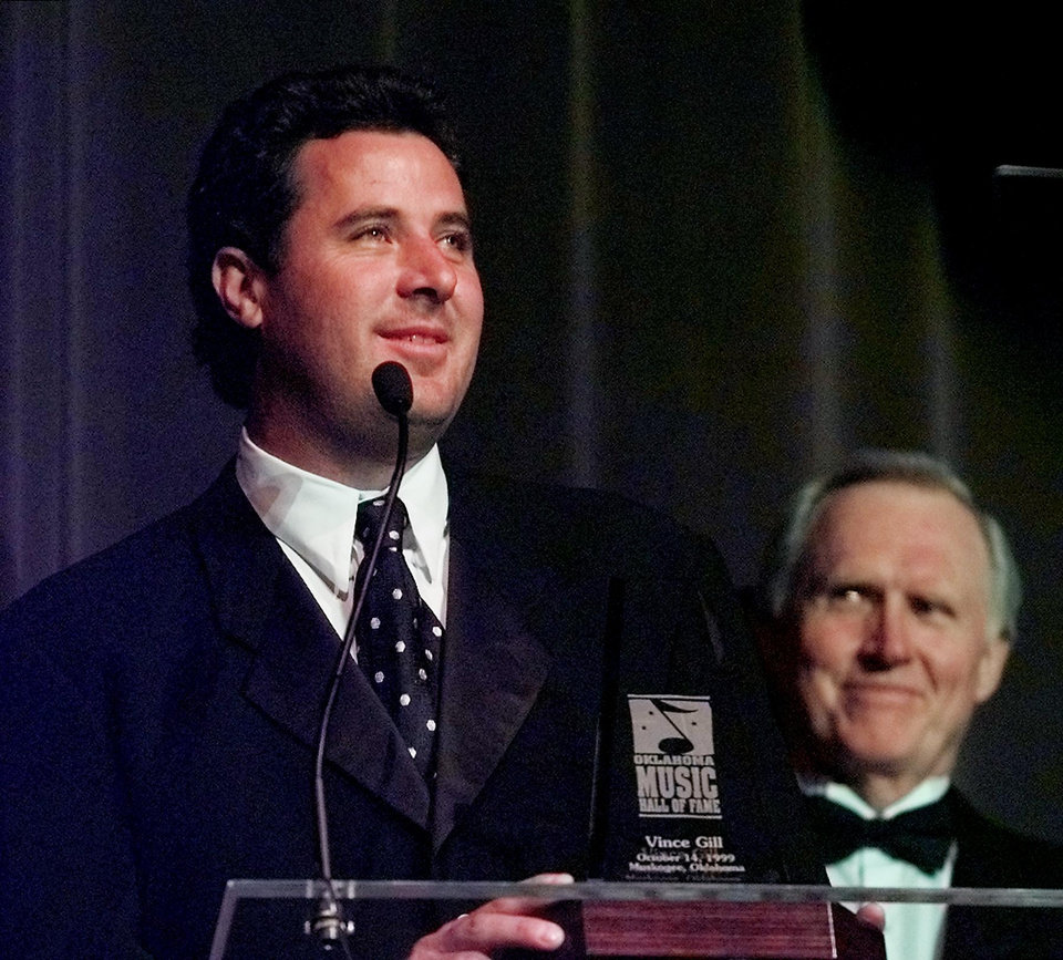 f78c9a579bbc01 Vince Gill speaks to audience after accepts his award from fellow Hall of  Fame inductee Byron