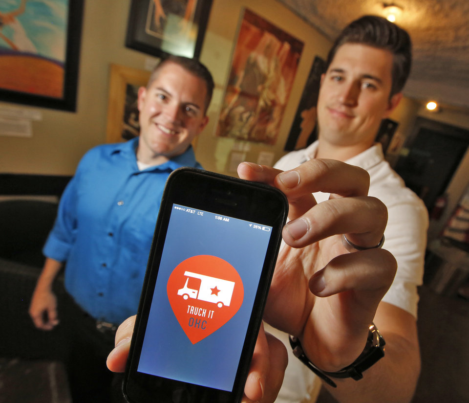 Photo - Truck It Co-Founders Josh DeLozier, left and Travis Stephens in Oklahoma City, Thursday  August  21, 2014.