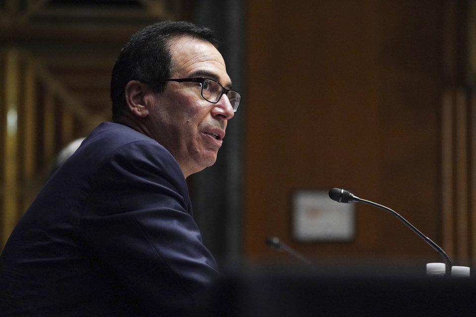 Photo -  Treasury Secretary Steve Mnuchin testifies Wednesday during the Senate's Committee on Banking, Housing, and Urban Affairs hearing examining the quarterly CARES Act report to Congress on Capitol Hill in Washington. [Toni L. Sandys/The Washington Post via The Associated Press]