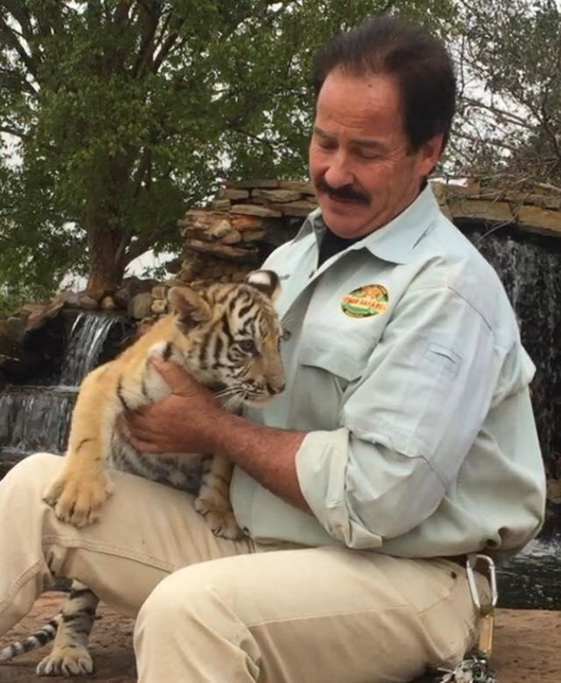 Photo -  Bill Meadows, owner of Tiger Safari in Tuttle, has come under fire from the Humane Society of the United States for allowing visitors to handle tiger cubs at his zoo. [Facebook photo]