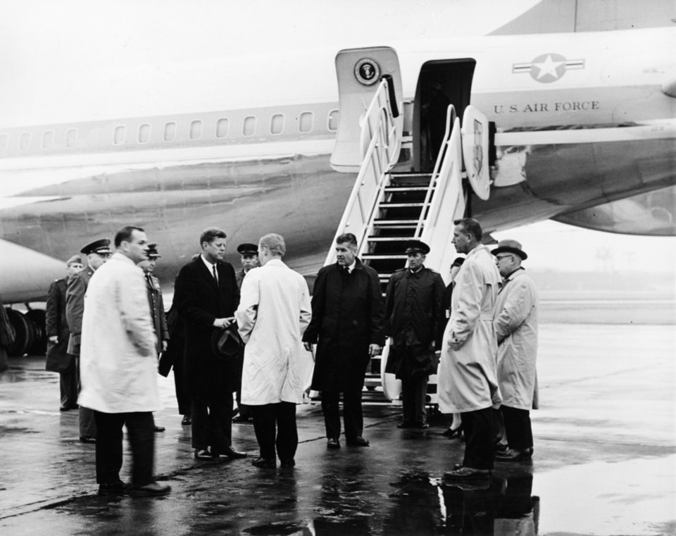 "Photo - STATE, OKLAHOMA, VISIT, VISITS: President John F. Kennedy is greeted by Oklahoma Governor J. Howard Edmondson (in light coat facing President Kennedy) on President Kennedy's arrival Friday at Tinker Air Force Base for the funeral of Oklahoma Senator Robert S. Kerr. Sen. Kerr passed away 1/1/63. Staff photo by Richard ""Dick"" Cobb taken Friday, 1/4/63; photo ran in the 1/5/63 Oklahoma City Times."