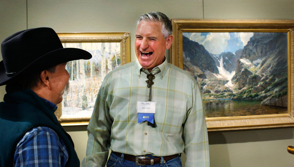 "Photo - Iowa artist Andrew Peters, right,  enjoys the compliments offered by a man while being congratulated  after he and his oil painting, ""The Lake of Glass,"" were honored as this year's Prix de West winner at the National Cowboy and Western Heritage Museum on Saturday, June 13, 2015. Peters, 60, from Council Bluffs, used a setting in Rocky Mountain National Park as the inspiration for his 30"" x 40' piece of art. Photo by Jim Beckel, The Oklahoman."