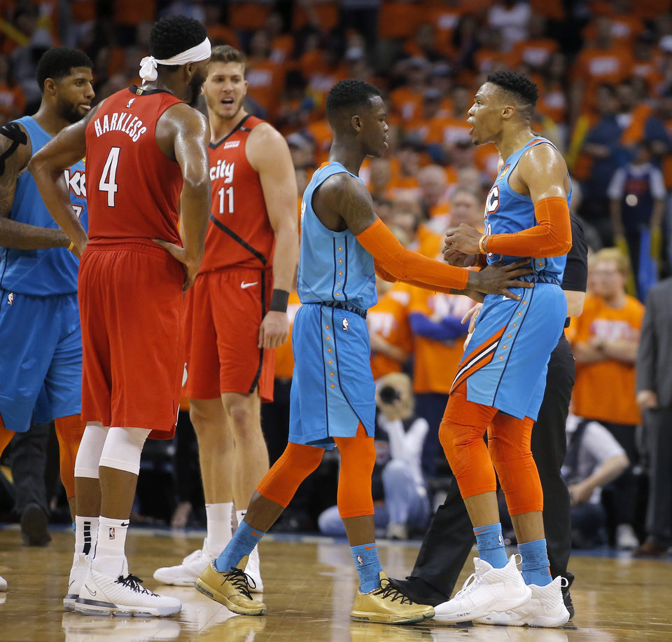 Photo - Oklahoma City's Dennis Schroder (17) stands in front of Russell Westbrook (0) as he argues after getting a technical foul during Game 3 in the first round of the NBA playoffs between the Portland Trail Blazers and the Oklahoma City Thunder at Chesapeake Energy Arena in Oklahoma City, Friday, April 19, 2019. Oklahoma City won 120-108. Photo by Bryan Terry, The Oklahoman