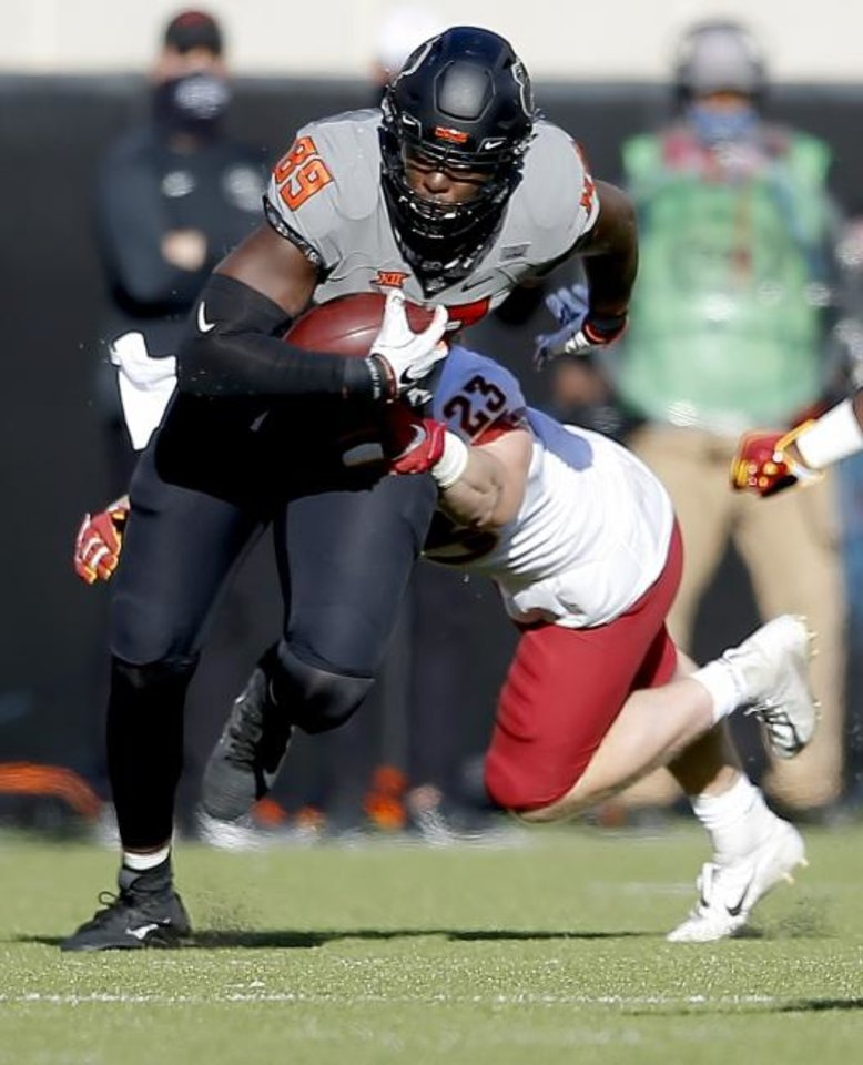 Photo -  Oklahoma State's Jelani Woods (89) runs after a catch Saturday against Iowa State. [SARAH PHIPPS/THE OKLAHOMAN]