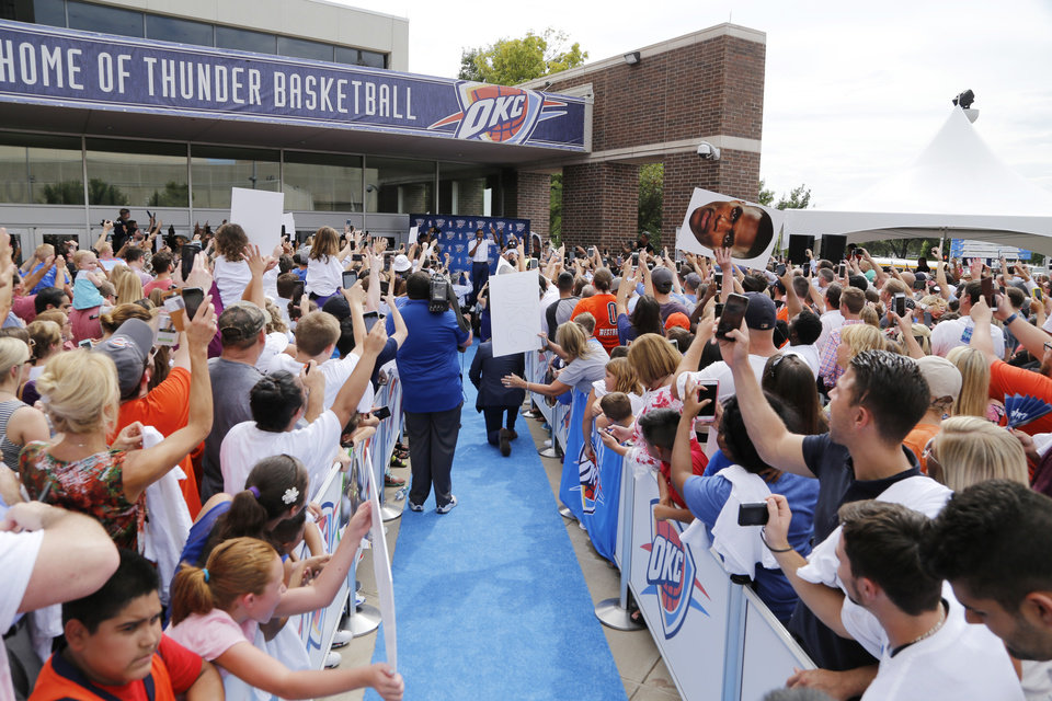 Photo - Russell Westbrook returns to sign an extension of his contract and is greeted by hundreds of Thunder fans outside of the Chesapeake Arena, Thursday, August 4, 2016. Photo by Doug Hoke, The Oklahoman