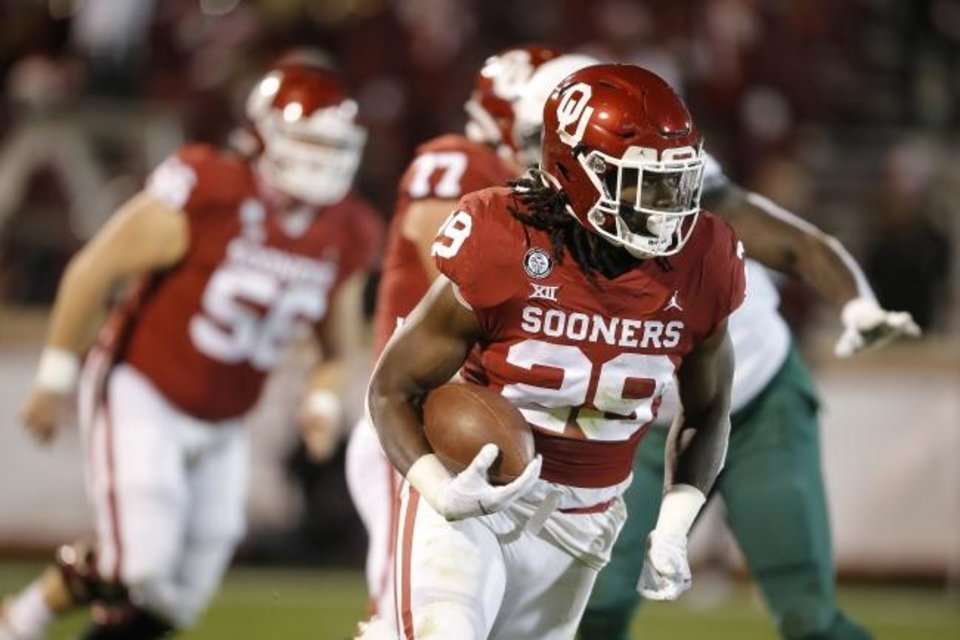 Photo -  Oklahoma's Rhamondre Stevenson (29) carries the ball during college football game between the University of Oklahoma Sooners (OU) and the Baylor Bears at Gaylord Family-Oklahoma Memorial Stadium in Norman, Okla., Saturday, Dec. 5, 2020. [Bryan Terry/The Oklahoman]