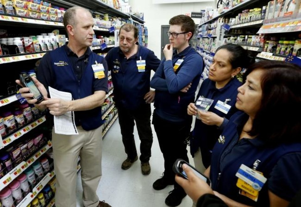 Photo -  Bell Isle Walmart trainer Kevin Early teaches a class to employees Lloyd Sanders, Andrew Holman, Regina Aguinaga and Cynthia Serbin in Oklahoma City in 2018. Walmart continues to implement technology in its grocery business. [Oklahoman Archives]