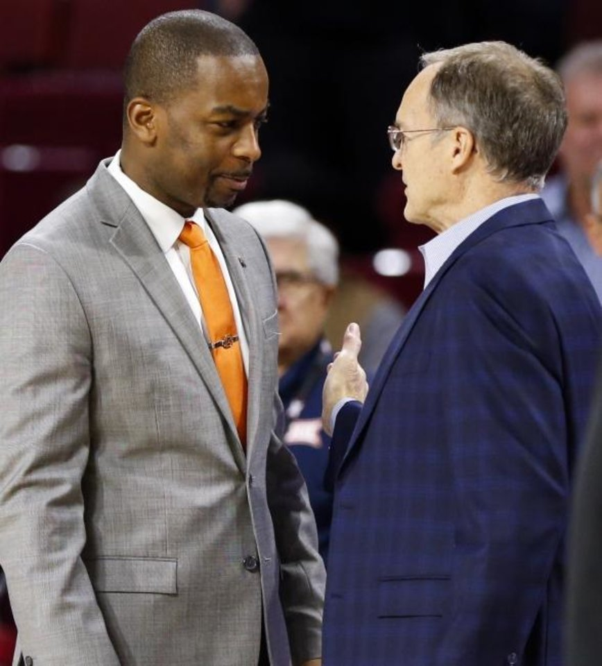 Photo -  Oklahoma State coach Mike Boynton, left, and Oklahoma coach Lon Kruger talk before at Bedlam basketball game. The Cowboys and Sooners are both 4-2 in the Big 12/SEC Challenge. [Nate Billings/The Oklahoman]