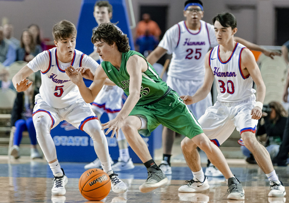 Photo - Leedey's Jack Harrel (35) drives the ball against Hammon's Jaxon Spikes (5) and Alex Little (30) during a Class B boys state tournament semi-final basketball game between Hammon vs Leedey in the Jim Norick Arena at State Fair Park in Oklahoma City, Okla. on Friday, March 6, 2020.  [Chris Landsberger/The Oklahoman]