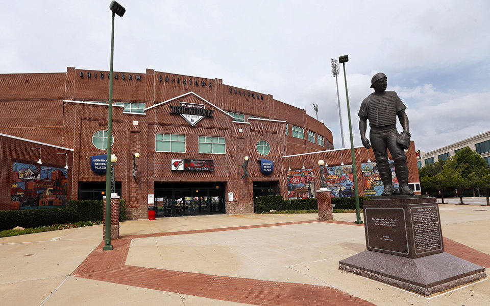Photo - BUILDING EXTERIOR: An exterior view of the Chickasaw Bricktown Ballpark and Johnny Bench statue looking southeast in downtown Oklahoma City, Wednesday, June 19, 2013. Photo by Nate Billings, The Oklahoman