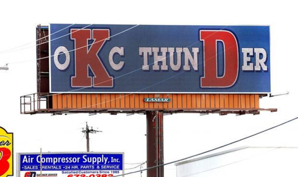 Photo - The message flashed across this electronic billboard near Grand Blvd. and S. Interstate 35 frontage road promotes Kevin Durant as a major part of the OKC Thunder team, as the campaign to convince Durant to remain as a player on the local NBA team has begun in Oklahoma City. (Photo by Jim Beckel, The Oklahoman)