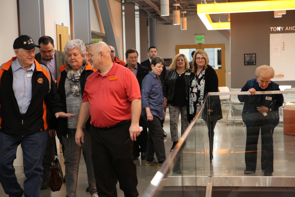 Photo - The N2O Innovators (Never Too Old) group from Spanish Cove Retirement Village gets a tour of OSU's engineering department. [PROVIDED]