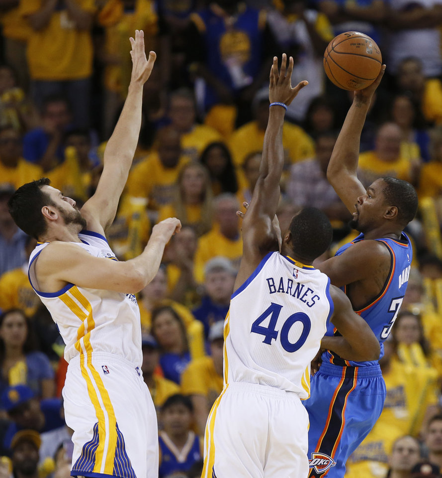 Photo - Oklahoma City's Kevin Durant (35) shoots over Golden State's Harrison Barnes (40) and Andrew Bogut (12) during Game 5 of the Western Conference finals in the NBA playoffs between the Oklahoma City Thunder and the Golden State Warriors at Oracle Arena in Oakland, Calif., Thursday, May 26, 2016. Photo by Nate Billings, The Oklahoman