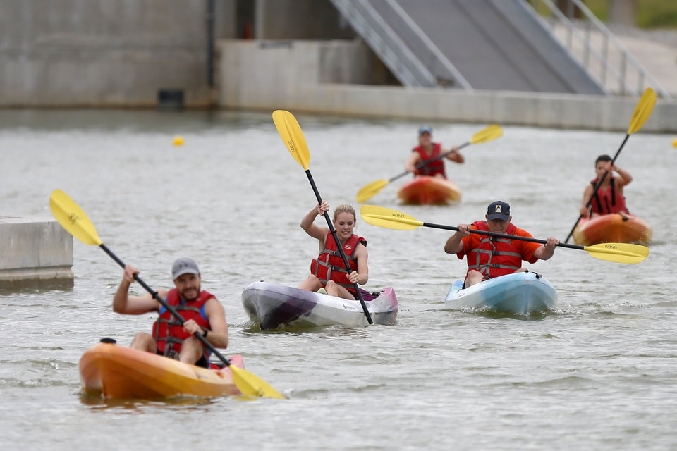 Photo -  Kayakers compete in the RIVERSPORT Challenge kayak and 5k race.