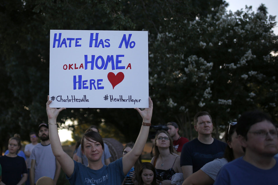 Photo - People stand during an Oklahoma Standing in Solidarity with Charlottesville Rally at the Oklahoma state Capitol in Oklahoma City,  Sunday, Aug. 13, 2017. Photo by Sarah Phipps, The Oklahoman