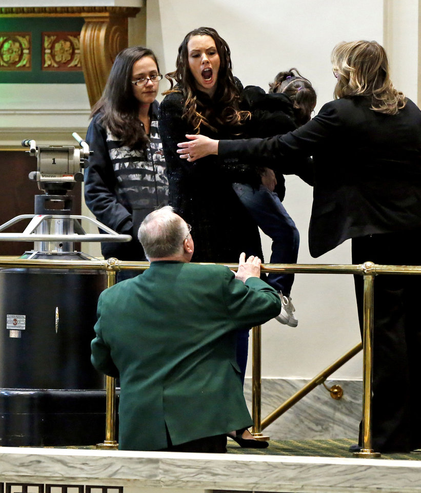 "Photo -  Brittany Warrior, of Tulsa, shown here holding her daughter, Jaque, screamed from the House visitors' gallery on Monday at the end of Gov. Mary Fallin's State of the State speech. Warrior was escorted from the gallery and questioned by Oklahoma Highway Patrol officers, but no charges were filed. Warrior declined to tell reporters outside the House chamber why she was angry at Fallin. ""I can't even talk about it right,'' she said. ""I'm just fighting for my baby's life.""  [Photo by Steve Sisney, The Oklahoman]"
