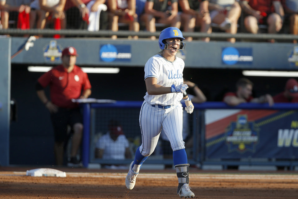 Photo - UCLA's Bubba Nickles (48) celebrates after hitting a home run in the first inning of the second NCAA softball game in the championship series of the Women's College World Series between Oklahoma and UCLA at USA Softball Hall of Fame Stadium in Oklahoma City, Tuesday, June 4, 2019. [Bryan Terry/The Oklahoman]