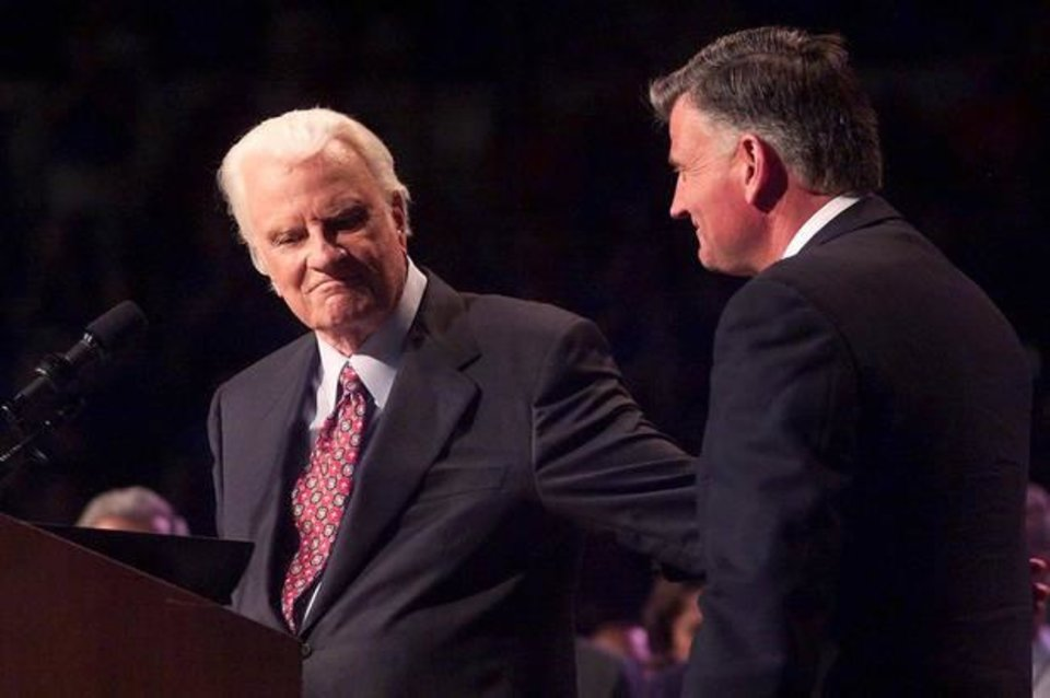 Photo - The Rev. Billy Graham stands at the podium next to his son the Rev. Franklin Graham during the Mission OKC evangelistic effort in June 2003 in Oklahoma City. [Photo by Doug Hoke, The Oklahoman]