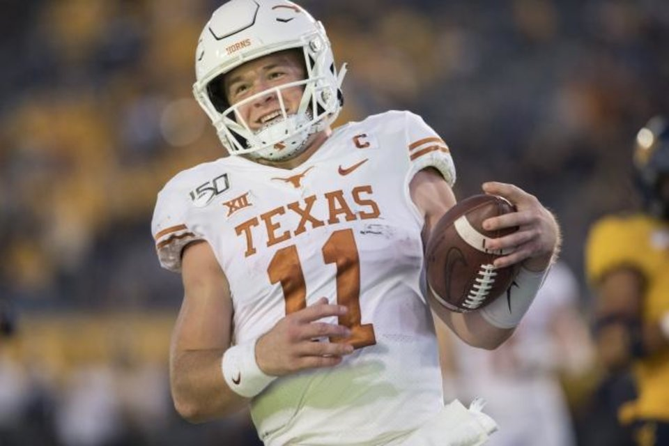 Photo -  With a win Saturday in the Red River Rivalry, Sam Ehlinger can become just the fourth Texas quarterback since World War II to beat the Sooners three times or more. [AP Photo/Raymond Thompson]