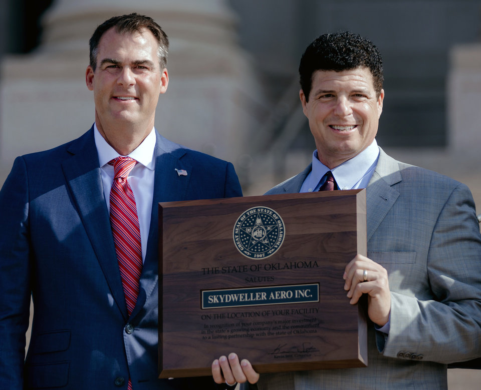 Photo - Gov. Kevin Stitt and Skydweller Aero CEO, Dr. Robert Miller pose for a photo  during a press conference to announce that aerospace company Skydweller Aero will establishing its headquarters in Oklahoma at the Oklahoma State Capitol on Tuesday, June 30, 2020, in Oklahoma City, Okla. [Chris Landsberger/The Oklahoman]