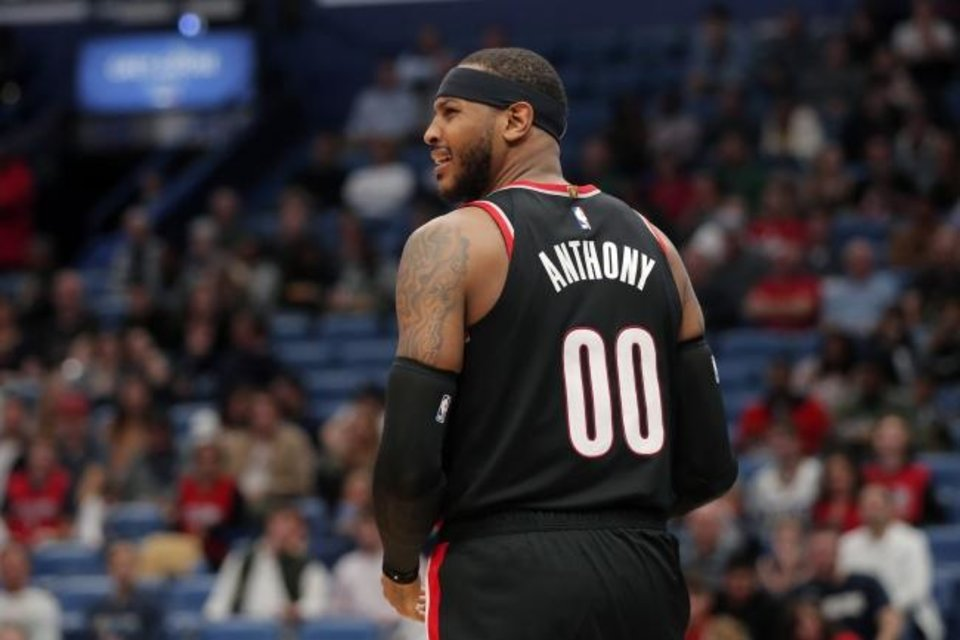 Photo -  Portland forward Carmelo Anthony will see a few familiar faces Wednesday night when the Trail Blazers host the Oklahoma City Thunder. Anthony played for OKC two seasons ago. [AP Photo/Gerald Herbert]