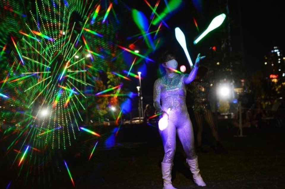 Photo -  A circus artist performs alongside Factory Obscura's Downtown Starlight Sept. 5 in Kerr Park. [Justin Waits photo]