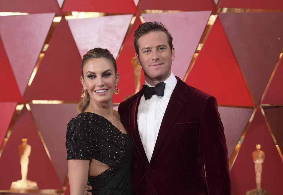 Photo - Elizabeth Chambers, left, and Armie Hammer arrive at the Oscars on Sunday, March 4, 2018, at the Dolby Theatre in Los Angeles. (Photo by Richard Shotwell/Invision/AP)