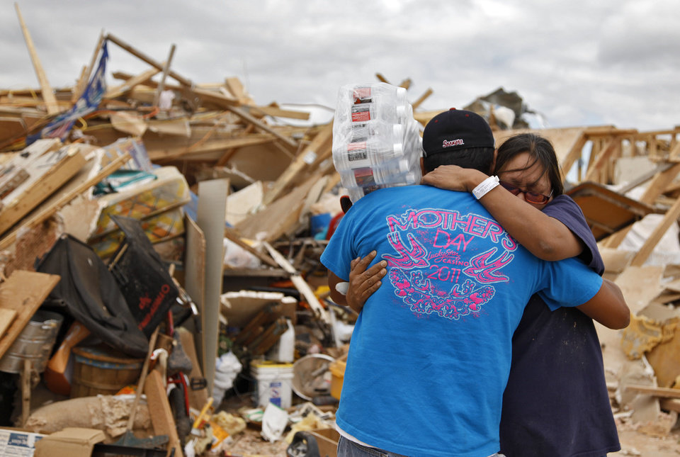 Photo - Susan Sleeper is hugged by family friend Fred Allrunner outside what use to be her home west of El Reno, Wednesday, May 25, 2011. Photo by Chris Landsberger, The Oklahoman