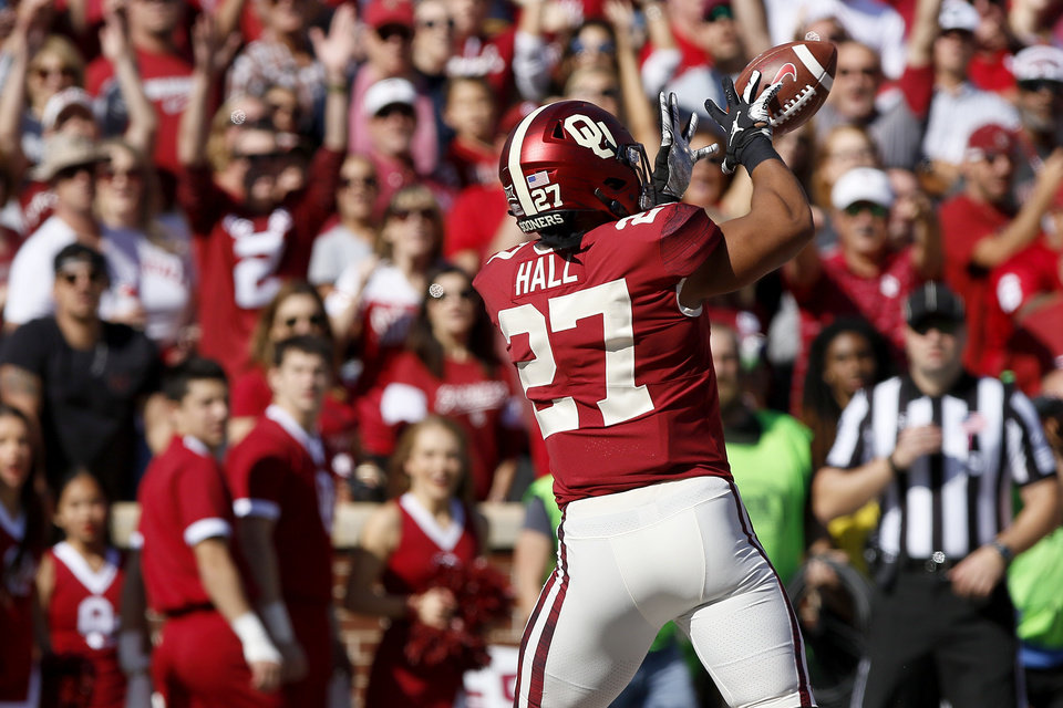 Photo - Oklahoma's Jeremiah Hall (27) catches a touchdown pass during a college football game between the University of Oklahoma Sooners (OU) and the West Virginia Mountaineers at Gaylord Family-Oklahoma Memorial Stadium in Norman, Okla, Saturday, Oct. 19, 2019. Oklahoma won 52-14. [Bryan Terry/The Oklahoman]