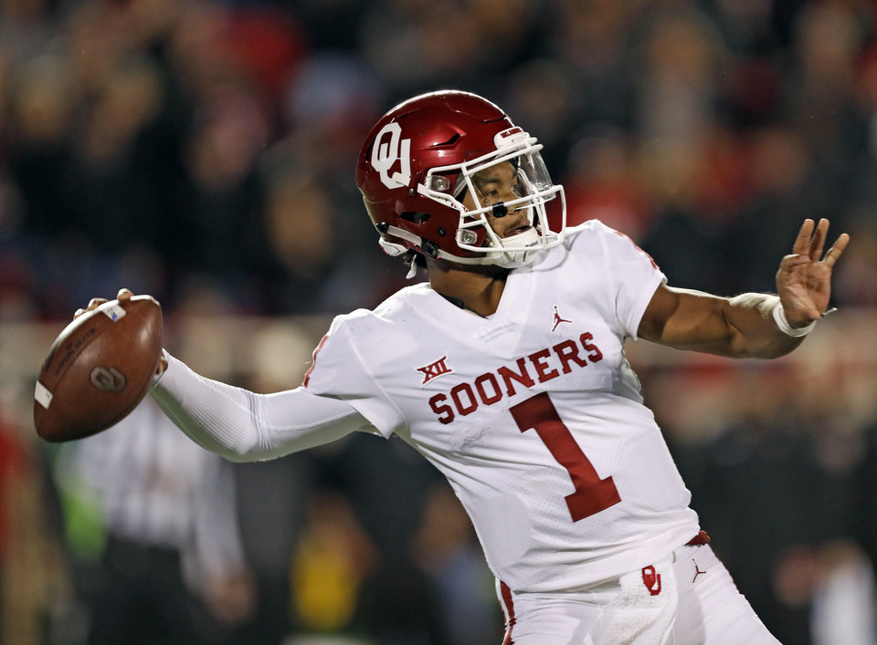 Photo - Oklahoma's Kyler Murray (1) passes the ball downfield during the first half of an NCAA college football game against Texas Tech, Saturday, Nov. 3, 2018, in Lubbock, Texas. (AP Photo/Brad Tollefson)