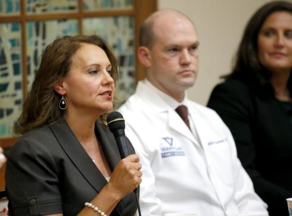 Photo -  Robyn Sunday-Allen, Chief Executive Officer of the Oklahoma City Indian Clinic, speaks about health care during a town hall on Saturday with U.S. Rep. Kendra Horn at St. Charles Borromeo Catholic Church in Warr Acres.  [Sarah Phipps/The Oklahoman]