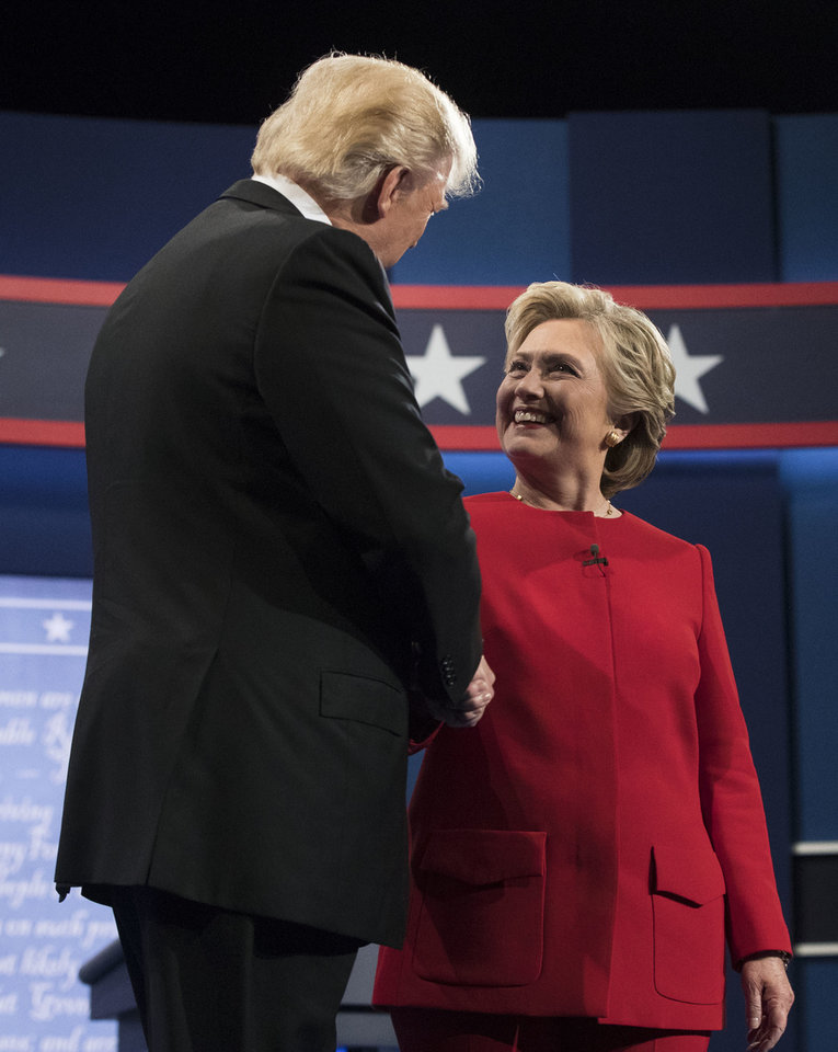 Photo - Republican presidential nominee Donald Trump shakes hands with Democratic presidential nominee Hillary Clinton during the presidential debate at Hofstra University in Hempstead, N.Y., Monday, Sept. 26, 2016. (AP Photo/Matt Rourke)
