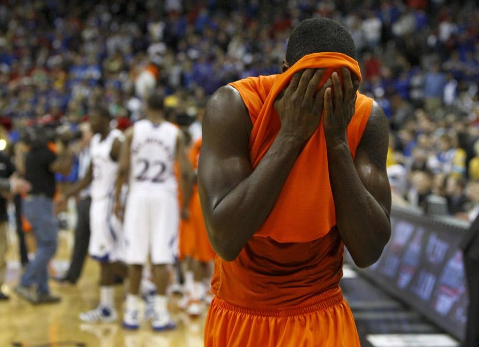 Photo -  OKLAHOMA STATE UNIVERSITY / BIG 12 TOURNAMENT / REACTION: OSU's Jean-Paul Olukemi reacts after OSU's loss in the college basketball Big 12 Championship tournament game between Oklahoma State-Kansas in Kansas City, Mo., Thursday, March 10, 2011.  Photo by Bryan Terry, The Oklahoman    ORG XMIT: OKC1103091441540726 KOD