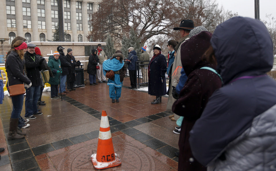Photo - Volunteers shield guests form a protestor following Oklahoma Muslim Day at the state Capitol in Oklahoma City Friday, Feb. 27, 2015. Photo by Sarah Phipps, The Oklahoman