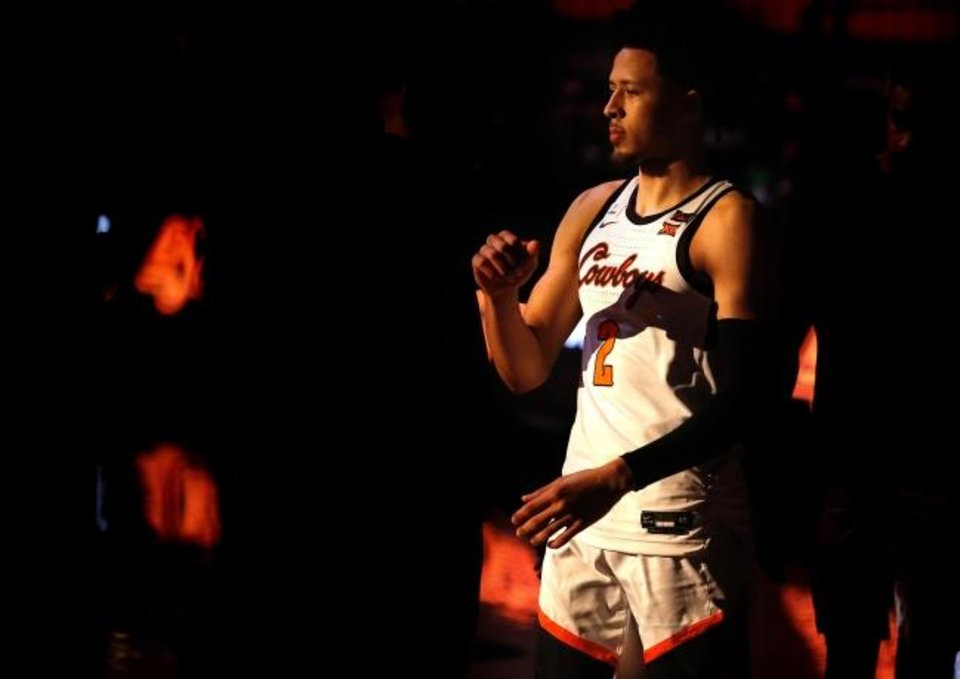 Photo -  Oklahoma State's Cade Cunningham became the No. 1-ranked player in the country as a senior in high school after a grueling transition to point guard under the guidance of his brother, Cannen, and cousin Ashton Bennings. [Sarah Phipps/The Oklahoman]