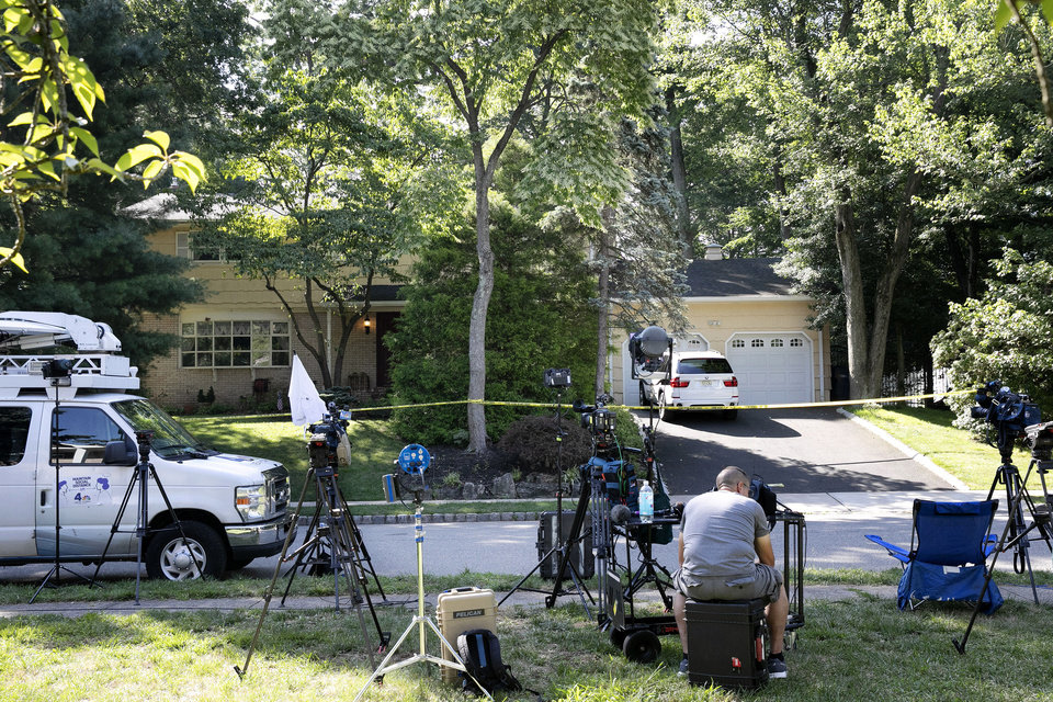 Photo -  News media is set up in front of the home of U.S. District Judge Esther Salas, Monday, July 20, 2020, in North Brunswick, N.J. A gunman posing as a delivery person shot and killed Salas' 20-year-old son and wounded her husband Sunday evening at their New Jersey home before fleeing, according to judiciary officials.  (AP Photo/Mark Lennihan)