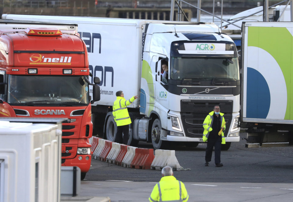 Photo -  Customs officials check vehicles at the P&O ferry terminal in the port at Larne on the north coast of Northern Ireland, Friday, Jan. 1, 2021.  This New Year's Day is the first day after Britain's Brexit split with the European bloc's vast single market for people, goods and services, and the split is predicted to impact the Northern Ireland border. (AP Photo/Peter Morrison)