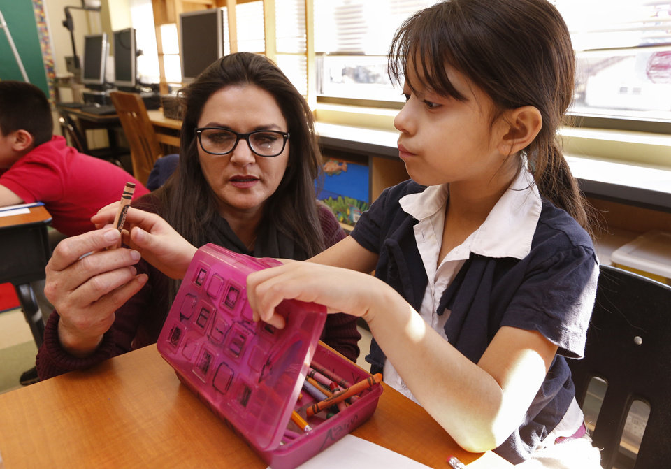 Photo -  Ayline Saenz-Gomez, first grade, gets help from Linda Lopez at Hawthorne Elementary School on Wednesday, Jan. 13, 2016 in Oklahoma City, Okla. Photo by Steve Sisney, The Oklahoman