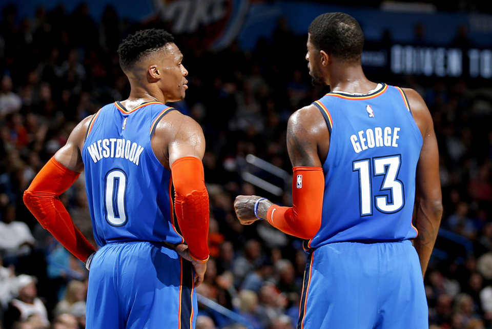 Photo - Oklahoma City's Russell Westbrook (0) and Paul George (13) talk during the NBA game between the Oklahoma City Thunder and the Utah Jazz at the Chesapeake Energy Arena, Friday, Feb. 22, 2019. Photo by Sarah Phipps, The Oklahoman