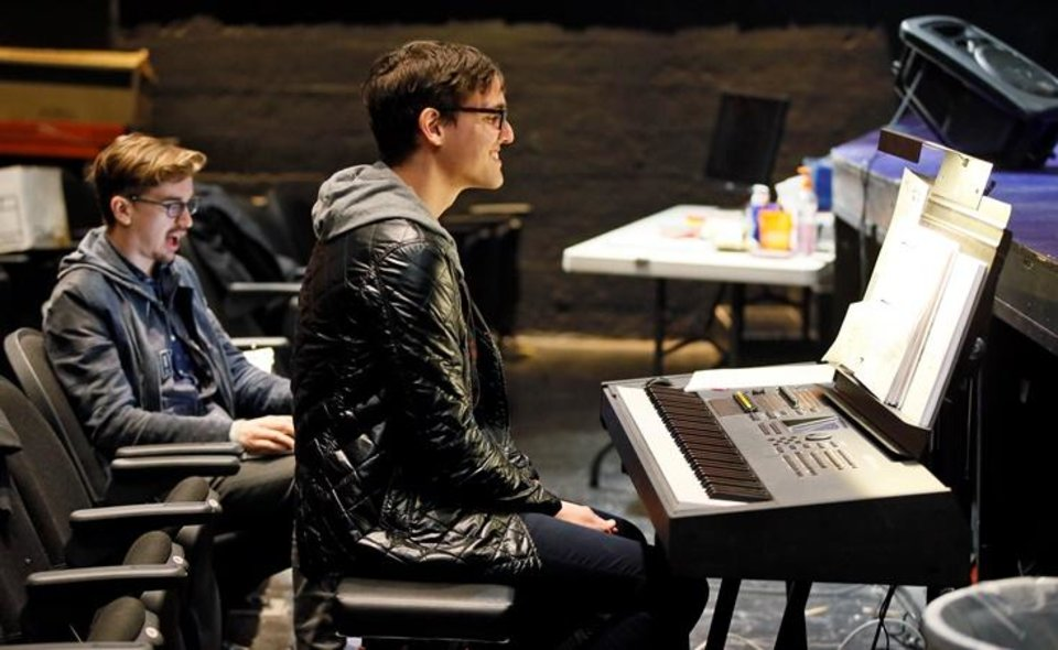 Photo - Music director James Dobinson, at the keyboard, and orchestrator Neil Douglas Reilly work during a rehearsal for Lyric Theatre's new musical