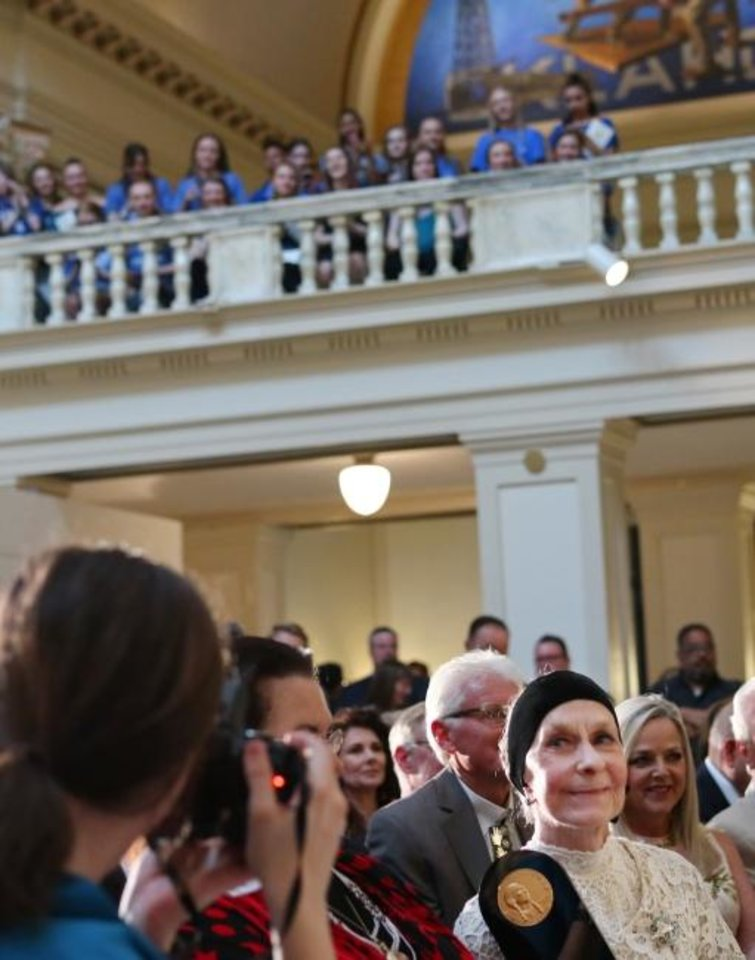 Photo -  A large crowd of Oklahoma City University dance students gathers to root for their mentor Jo Rowan, below in the head band, at the Governor's Arts Awards at the Capitol, Tuesday, April 16, 2019. Rowan, the chairman of the Ann Lacy School of American Dance & Entertainment, received the prestigious Governor's Award. [Photo by Doug Hoke/The Oklahoman]