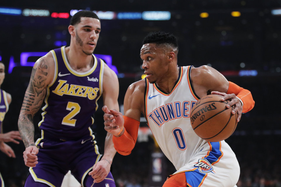 Photo - Oklahoma City Thunder's Russell Westbrook, right, drives past Los Angeles Lakers' Lonzo Ball during the first half of an NBA basketball game Wednesday, Jan. 2, 2019, in Los Angeles. (AP Photo/Jae C. Hong)