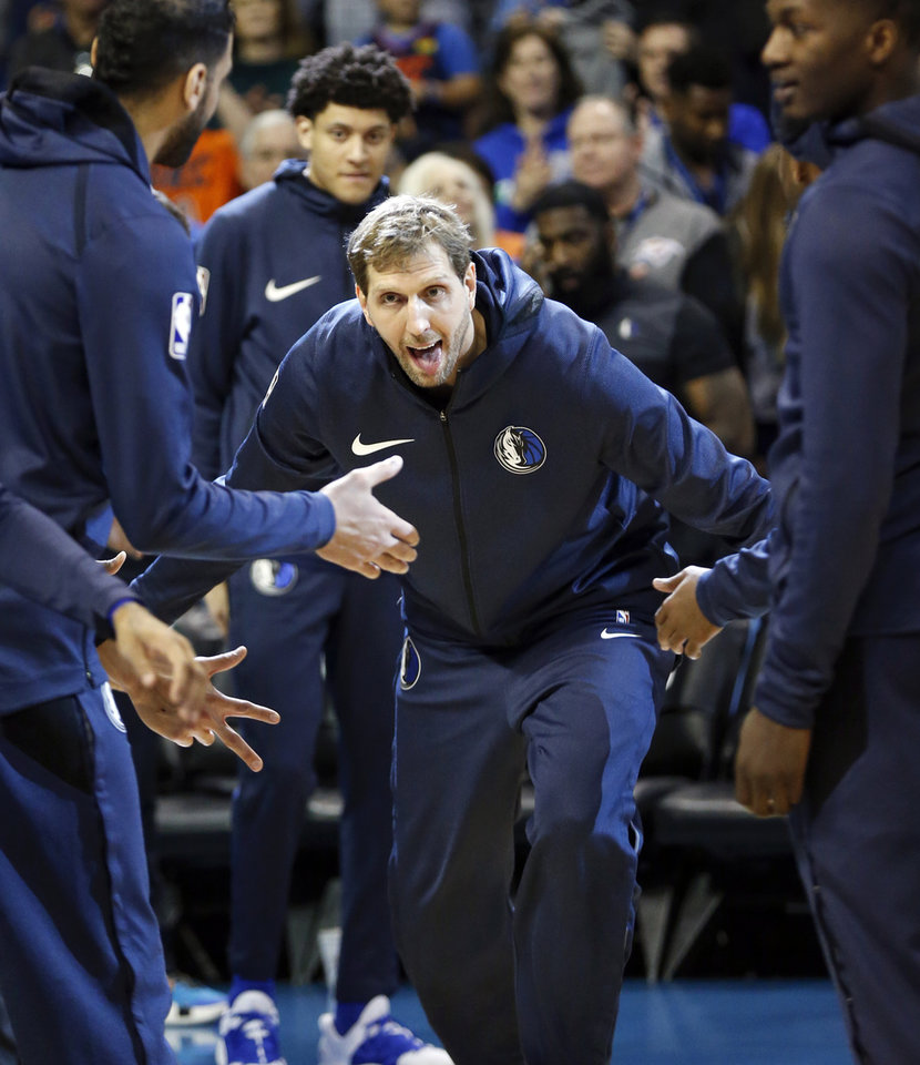 Photo - Dallas' Dirk Nowitzki (41) runs on the court during player introductions before an NBA basketball game between the Dallas Mavericks and the Oklahoma City Thunder at Chesapeake Energy Arena in Oklahoma City, Sunday, March 31, 2019. Photo by Nate Billings, The Oklahoman